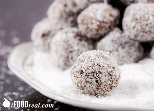 Healthy No Bake Coconut Protein Balls Recipe with whey protein powder, dates, almonds and coconut flakes.