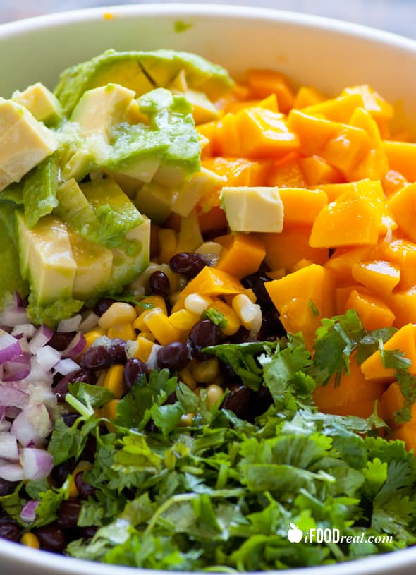 This Mango Black Bean Salad is a mix between corn and black bean salad, mango salad and guacamole. It is rich in protein, healthy fats and fiber.