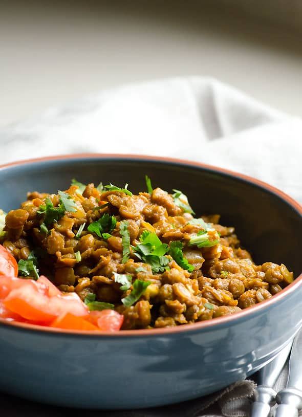 Easy Green Lentil Curry served in a bowl with salad