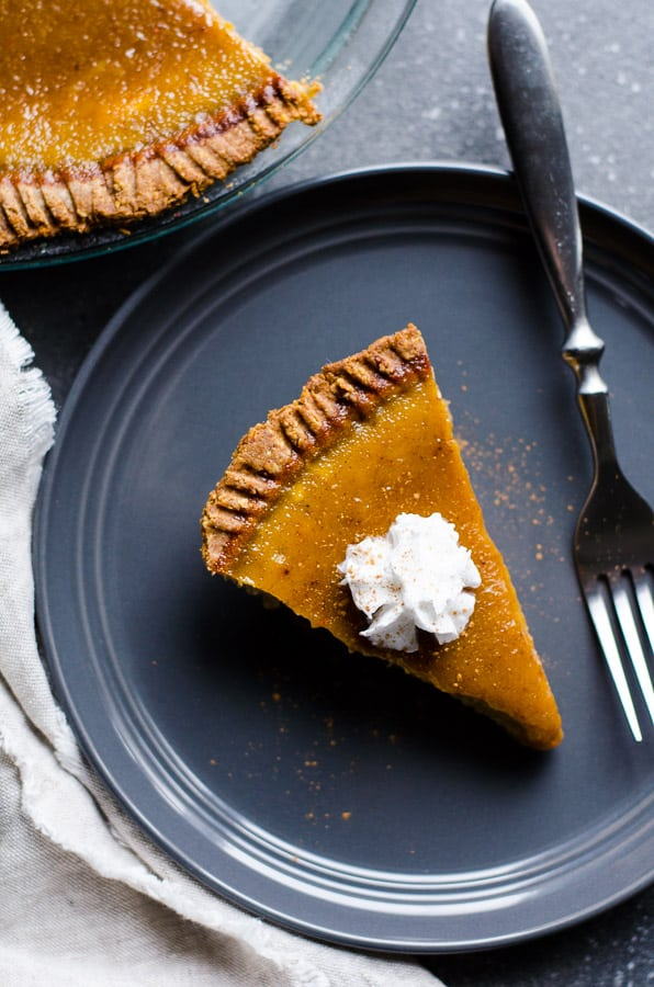 healthy pumpkin pie on a gray plate with a fork
