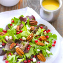 FG-3Baby-Greens-Salad-Pecans-Pomegranate-Goat-Cheese-Mango-Dressing