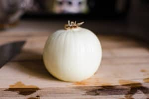 whole onion on a board