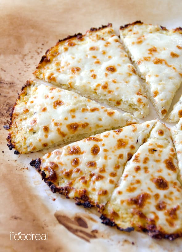 Cauliflower Pizza Crust Recipe that is low calorie & low carb. Can take on any of your favourite toppings. Foolproof recipe with step by step instructions. | ifoodreal.com