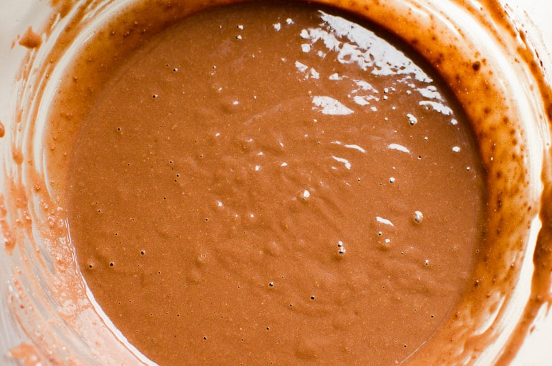 healthy chocolate cake batter in glass bowl