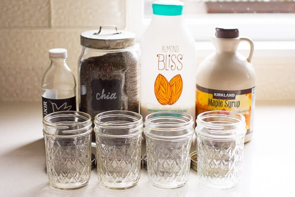 chia seeds, milk, maple syrup, vanilla extract and glass jars