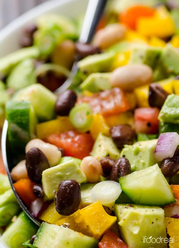 Mexican Bean Salad Recipe is a healthy vegetable salad with avocado, mixed beans, tomato, cucumber, bell pepper, cilantro, lime and cumin. Can be made ahead and is perfect for potlucks. | ifoodreal.com