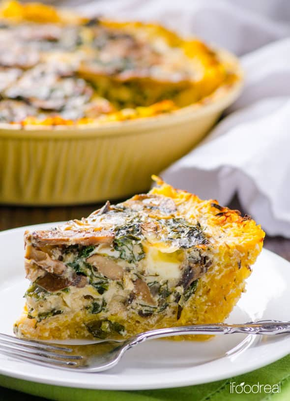 slice of Spaghetti Squash Quiche with Kale and Mushrooms on a white plate