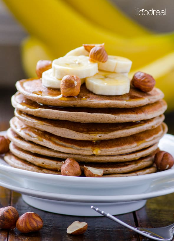 Cottage Cheese Protein Pancakes topped with sliced bananas and hazelnuts