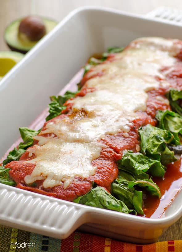 Low Carb Chicken Enchiladas Recipe with chicken breasts, mild green chile peppers/poblanos, easy homemade enchilada sauce and wrapped in swiss chard leaves, no tortilla. | ifoodreal.com