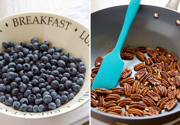 Bowl of blueberries; toasting pecans on a skillet