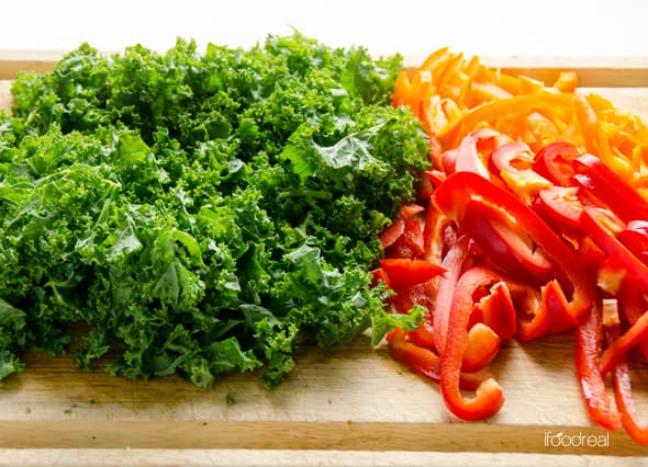 chopped kale and bell peppers on cutting board