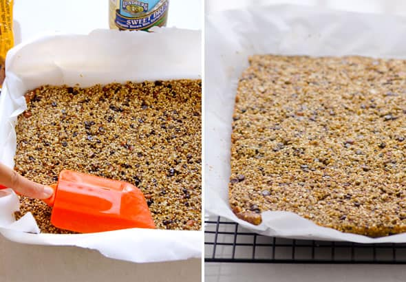 Pressing Quinoa Granola Bar mixture into parchment paper lined baking pan