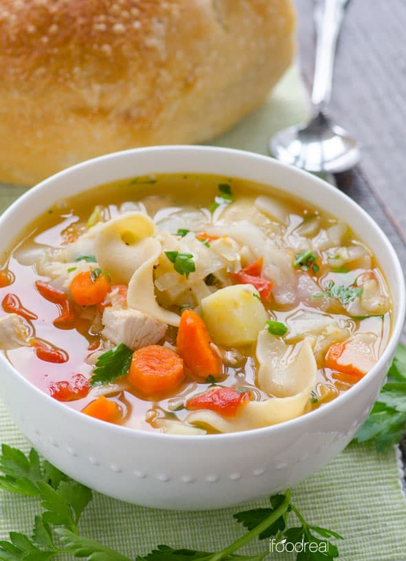 Chicken noodle vegetable soup is a healthy homemade chicken soup with carrot, cabbage, celery, potato and whole wheat pasta, with a slow cooker option.
