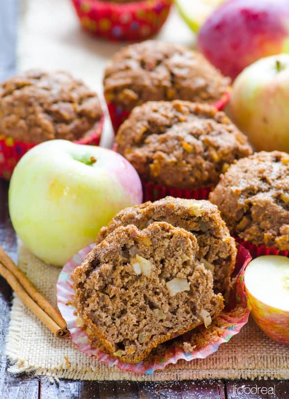 healthy apple muffin cut open with whole muffins cinnamon sticks and apples