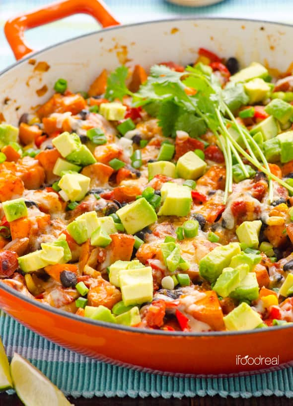Sweet Potato Skillet Tex Mex Style is healthy, vegetarian and gluten free. 30 minute weeknight dinner recipe with avocados, beans, corn and cheese. | ifoodreal.com