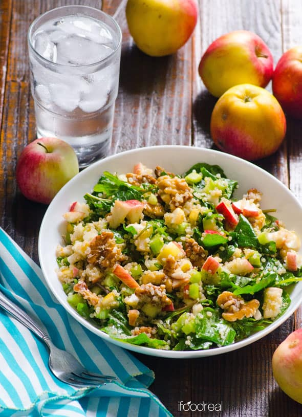kale and quinoa salad, apples and glass of water
