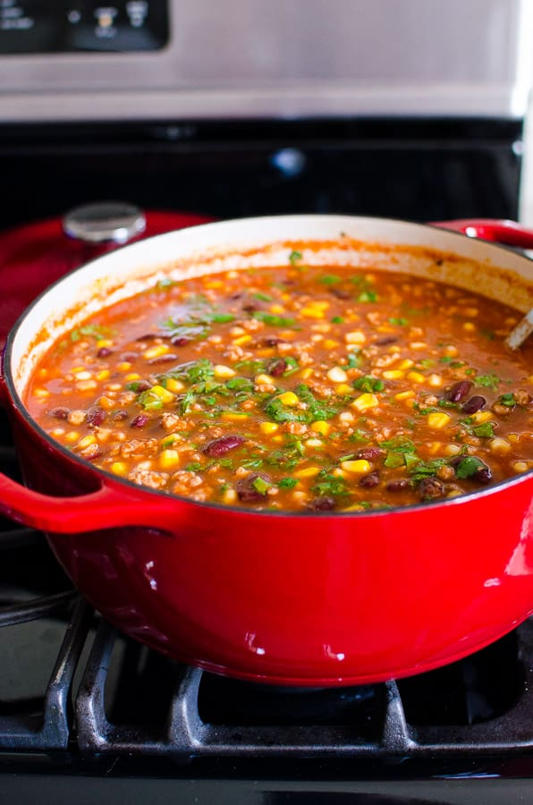Turkey Taco Soup Recipe made healthy with ground turkey, pantry ingredients, on a stovetop or in slow cooker. Either way it's hearty and delicious!