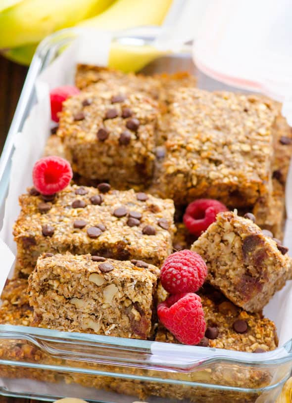 banana oat bars cup up in dish with raspberries