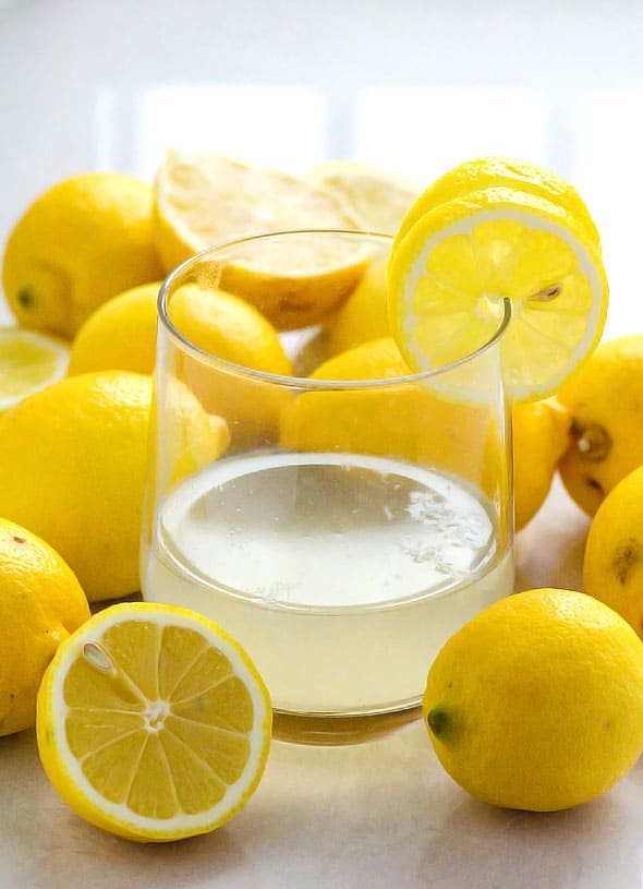 How to make lemon water at home or easy lemon water detox recipe video. Including health benefits of warm lemon water in the morning and how to prevent teeth enamel damage.