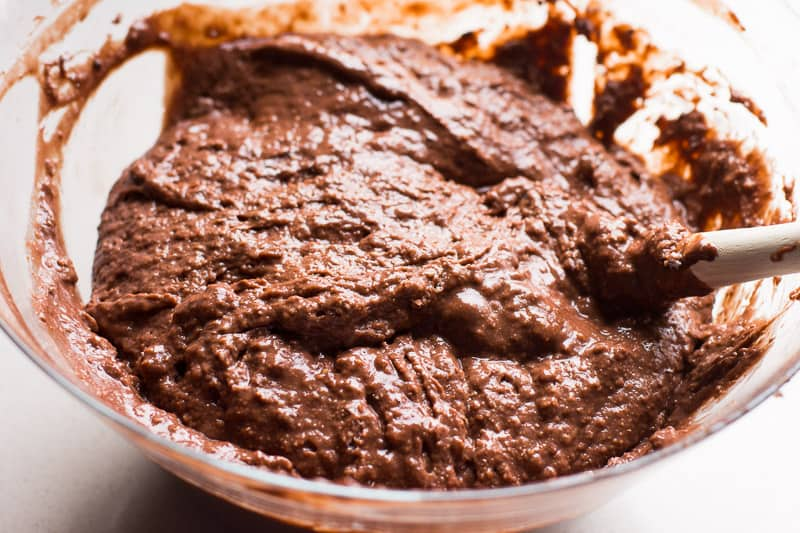 Healthy chocolate muffins recipe with greek yogurt, applesauce, whole wheat flour, cacao powder and honey. Kids absolutely love these fudgy and nutritious muffins.
