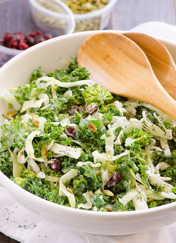 Sweet Kale Salad Recipe is a healthy version of famous salad kit: kale, cabbage, broccoli, pumpkin seeds & cranberries with homemade sweet kale salad dressing. | ifoodreal.com