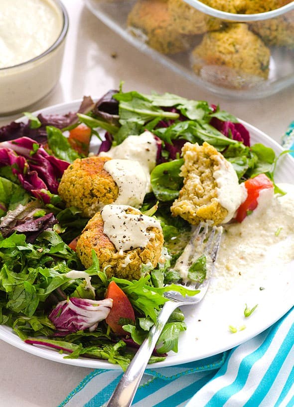 Quinoa Falafel served with side of salad on a white plate