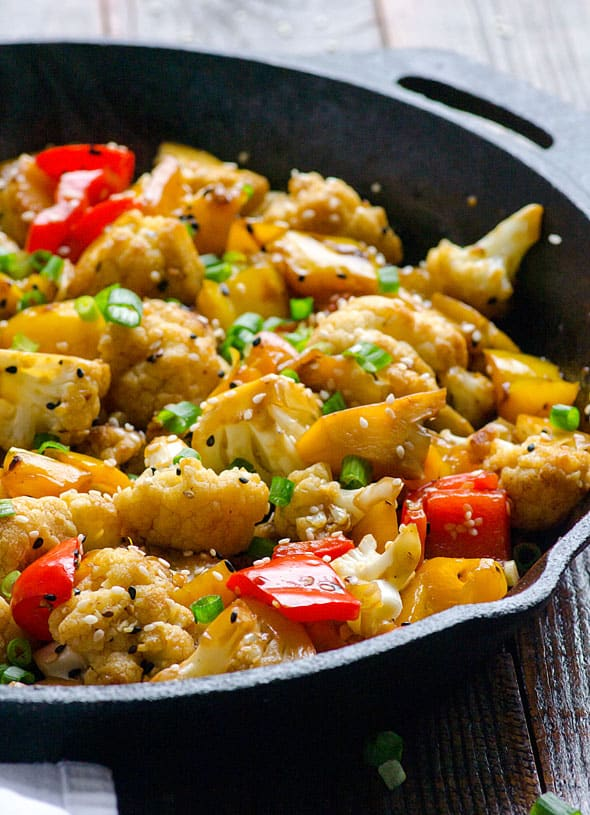 Sesame Cauliflower & Bell Peppers Recipe is easy healthy side dish made on a stovetop and ready in 10 minutes.