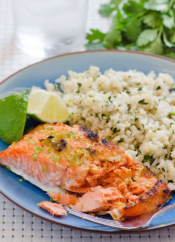 Lime Ginger Salmon with a side of rice on a blue plate
