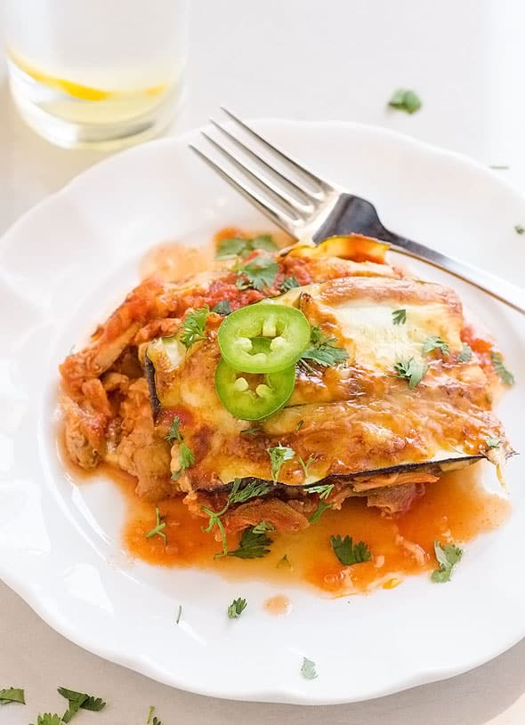 Healthy Chicken Zucchini Casserole Enchiladas Style with layers of cooked shredded chicken, sliced zucchini and homemade enchilada sauce. | ifoodreal.com