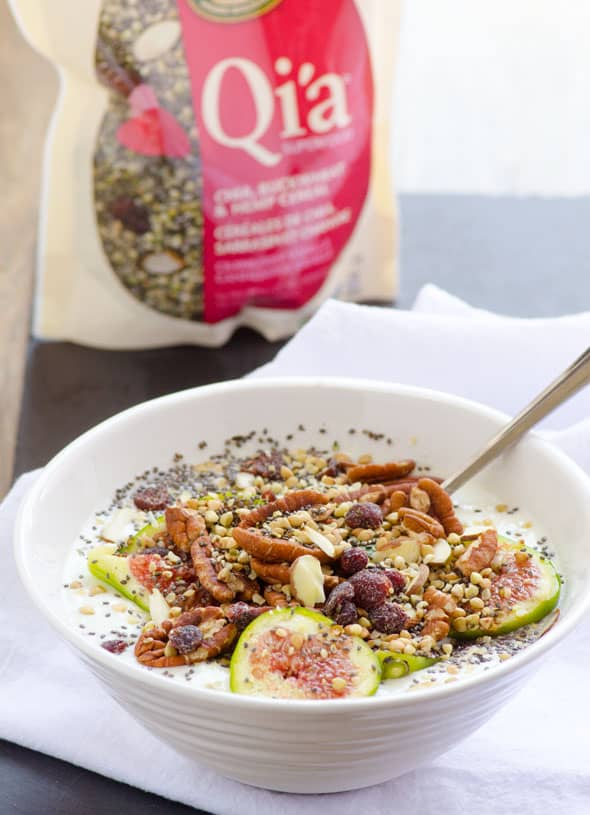 a bowl with yogurt, figs, granola and nuts for healthy breakfast