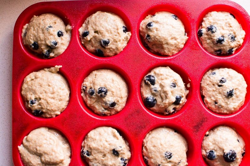 Healthy Blueberry Muffins with applesauce, spelt or whole wheat flour, honey or maple syrup, and fresh or frozen blueberries. A recipe with fantastic reviews!