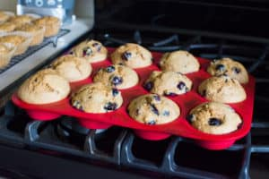 Healthy Blueberry Muffins in red silicone tin cooling on the stove