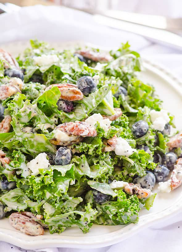 Kale Blueberry Salad Recipe with tender kale, soft goat cheese, easy candied pecans and healthy homemade poppy seed dressing. So good for hot summer days! | ifoodreal.com