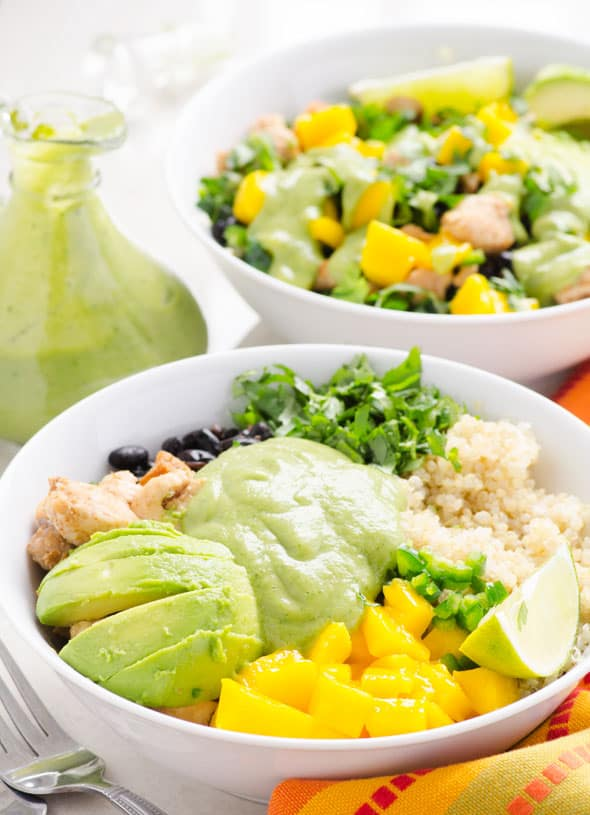 Chicken Quinoa Bowls Recipe with quinoa, kale, chili chicken, mango, black beans, cilantro, jalapeños and healthy Cilantro Avocado Dressing. | ifoodreal.com