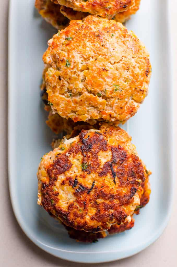 cooked salmon patties on a platter