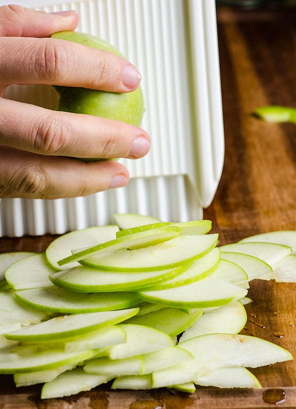 Slicing granny smith apples with mandoline