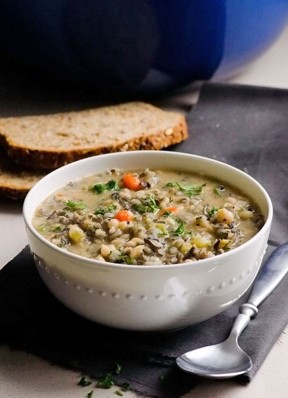 Hearty Beef and Bean Soup Recipe with beef soup bones, white beans, rice and chock full of vegetables. So good stick to your bones meal on a cold day.
