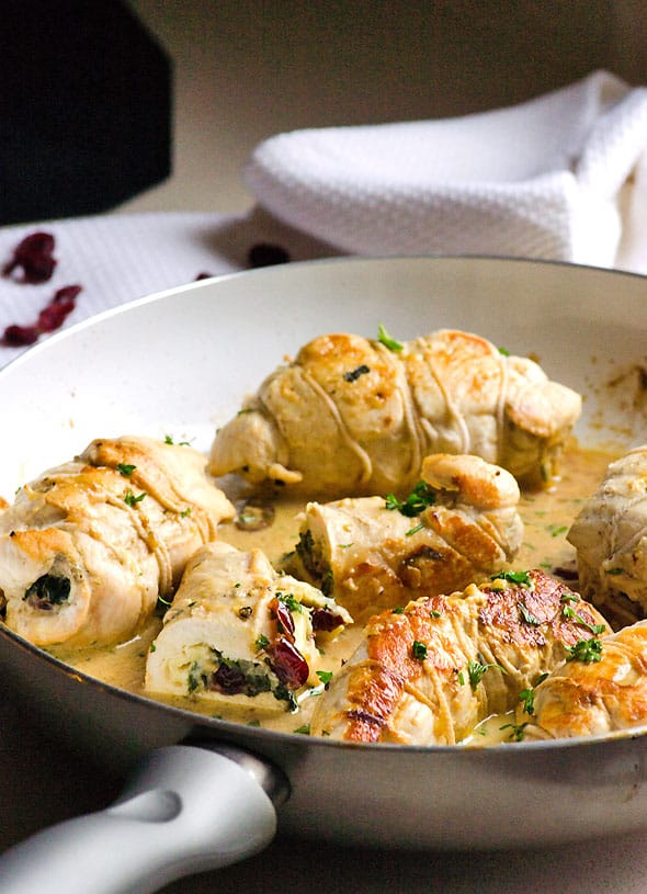 Chicken Stuffed with Brie, Spinach and Cranberries makes healthy simple dinner or a fancy chicken recipe for any occasion. Moist, flavourful and juicy. | ifoodreal.com