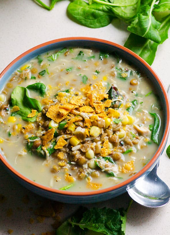 Slow Cooker Chicken Lentil Soup Recipe is Tex Mex flavoured soup with coconut milk, corn, green lentils, spinach, chicken and crushed tortilla chips on top. | ifoodreal.com
