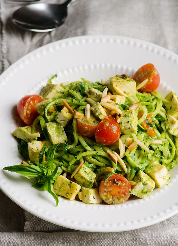 Pesto Chicken Zucchini Noodles - One skillet dinner recipe with your choice of protein, toasted almonds, grape tomatoes and vegan kale pesto. | ifoodreal.com
