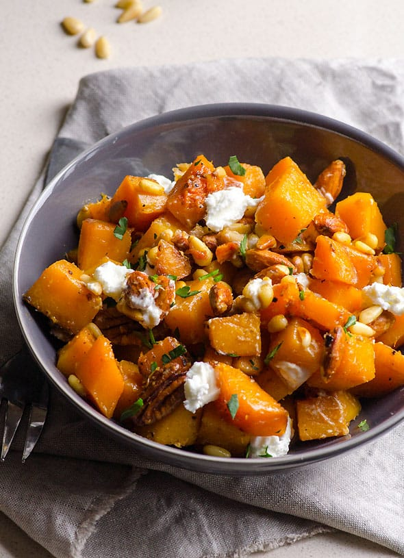 Honey Garlic Butternut Squash Recipe roasted on a skillet in 15 minutes and served with toasted nuts and soft goat cheese. Easy, tasty and healthy!