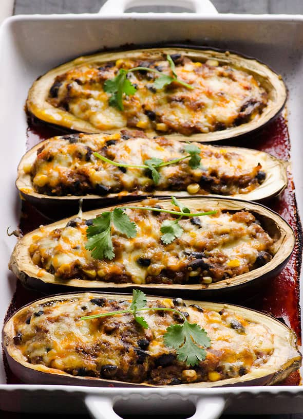 Quinoa Stuffed Eggplant Tex Mex style recipe is vegetarian eggplant stuffed with vegetables, quinoa, tomato sauce and baked with cheese on top. | ifoodreal.com