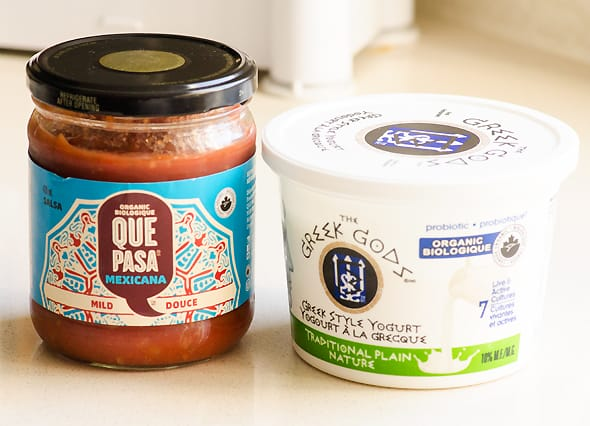 Containers of salsa and greek yogurt