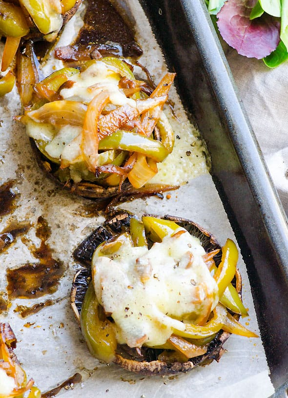 Philly Cheesesteak Stuffed Portobellos Recipe with green pepper and onion in tasty umami sauce topped with cheese for a low carb comfort dinner.