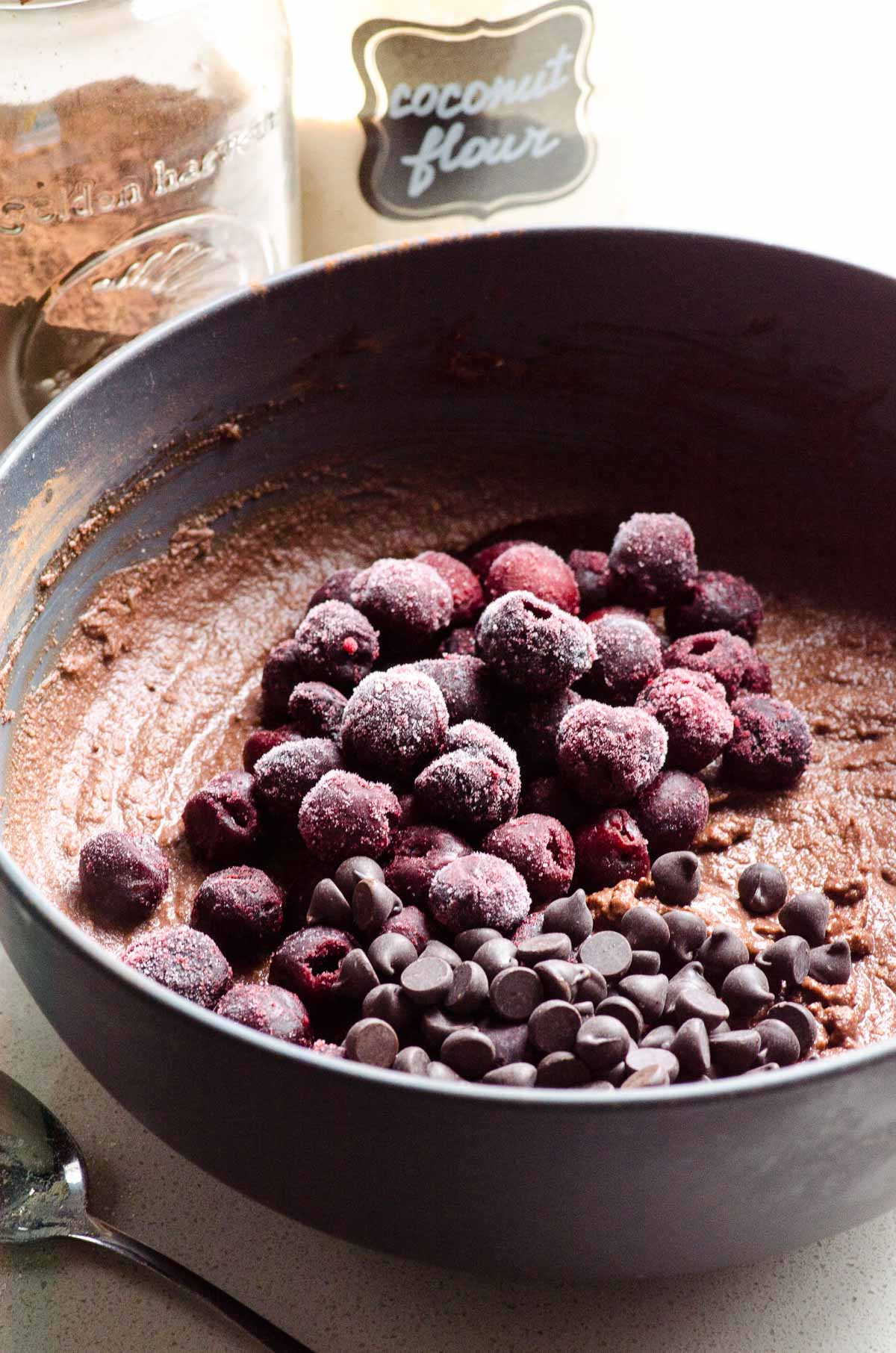 Frozen cherries and chocolate chips on top of batter