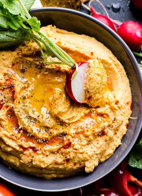 Sweet potato hummus recipe. With yams, chipotle in adobo and chickpeas. Delicious, creamy and perfect for veggie dipping
