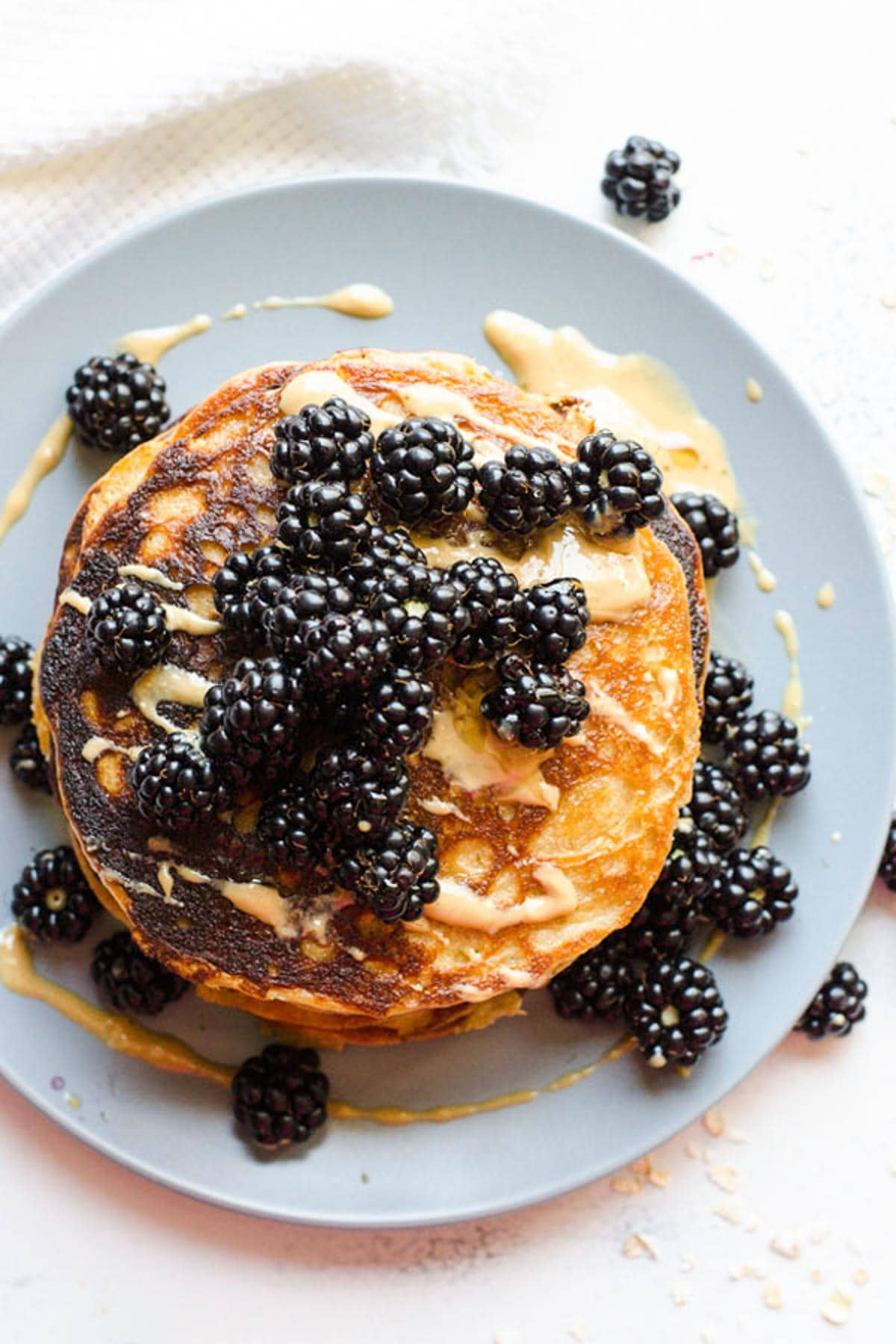 Peanut Butter Protein Pancakes on plate topped with blackberries