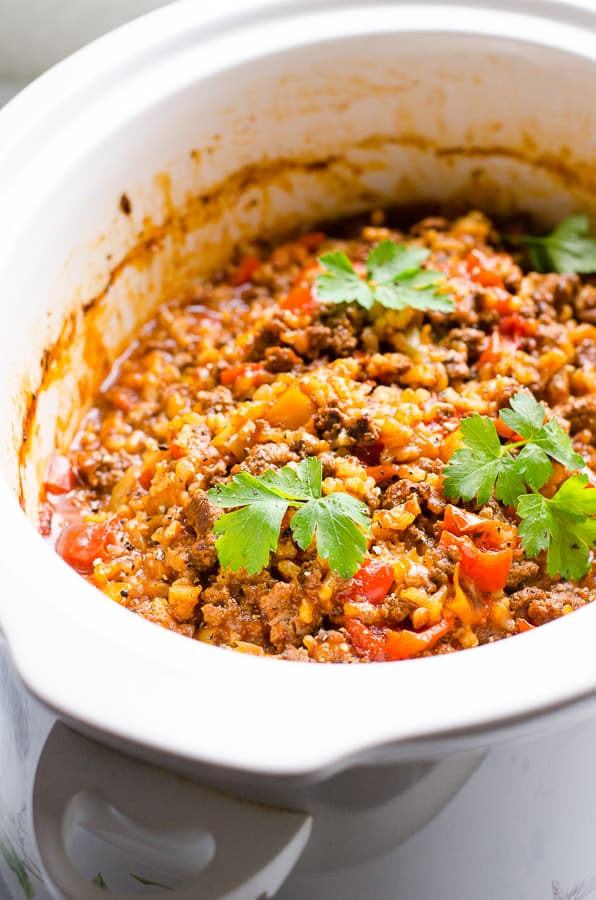Crock Pot Stuffed Pepper Casserole made with bell peppers, brown rice, ground turkey and tomato sauce . Simple unstuffed lazy peppers recipe in a slow cooker. | ifoodreal.com