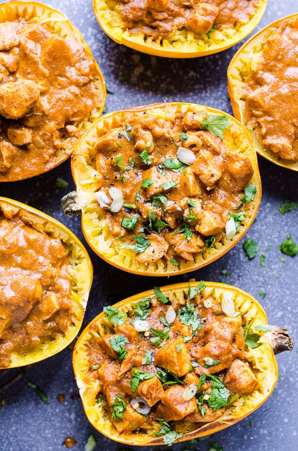 Butter chicken and spaghetti squash boats recipe with delicious coconut milk based curry sauce loaded with antioxidant spices. | ifoodreal.com