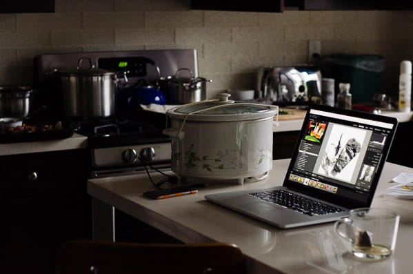view of kitchen with crock pot, laptop